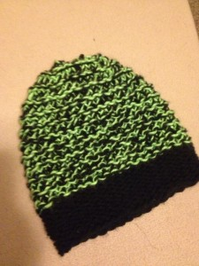 green and black knit hat